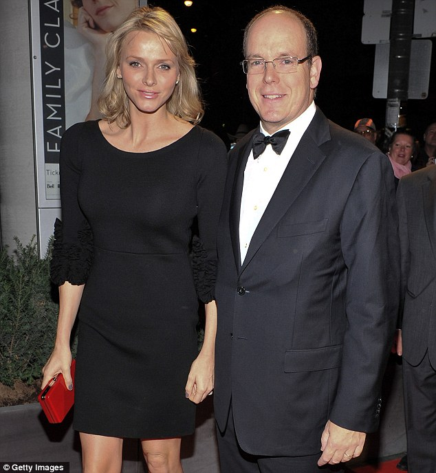 Glitz: Princess Charlene and Prince Albert arrive at the grand opening of Grace Kelly: From Movie Star to Princess in New York