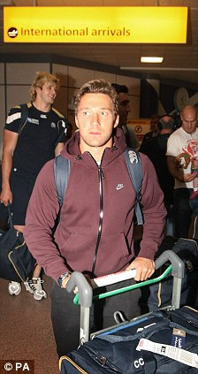 Welcome home: Scotland's Chris Cusiter arrives at Glasgow Airport
