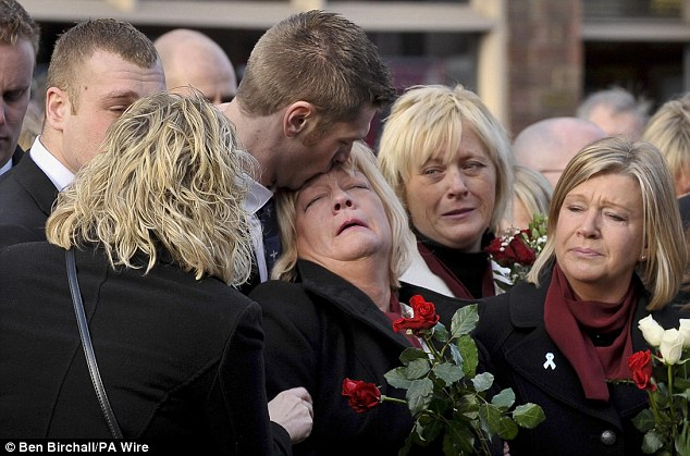 Devastated: Mother of Private Martin Bell, Elaine (centre), is comforted, as she waits for the hearse carrying his coffin to pass through Wootton Bassett as he is repatriated back to the UK in February