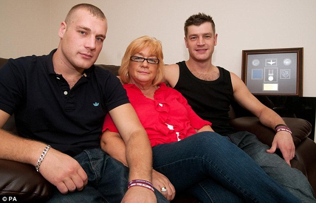 'No heroics:' Elaine at home in Idle, Bradford with her sons Philip (left) and Oliver (right)