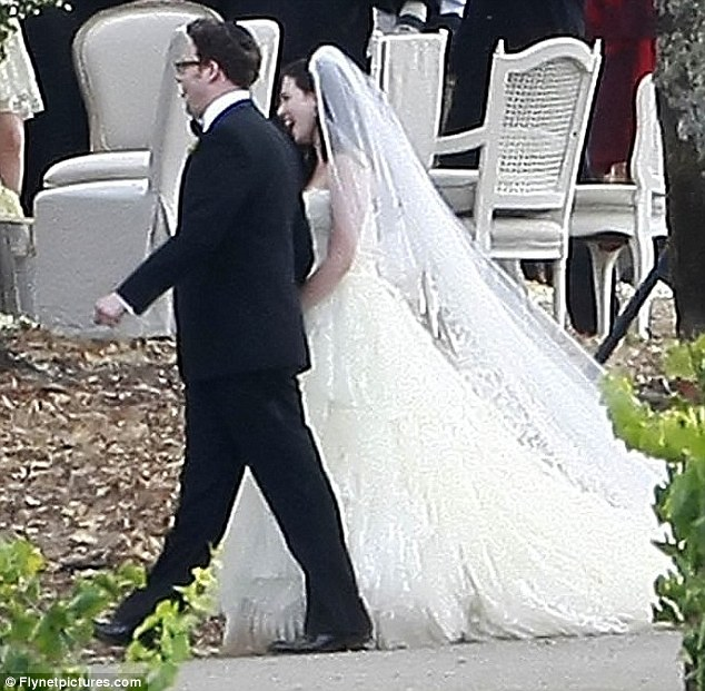 Here comes the bride: The writer wore a spectacular gown for her big day