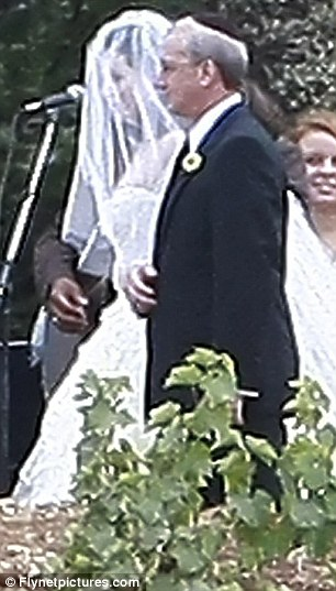 Traditional: The bride wore a veil along with her princess dress