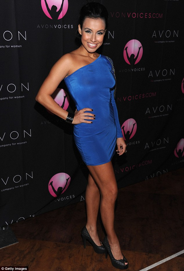 Adding some colour: Colombian singing star Maia wore an electric blue one-shoulder dress with peep toe heels