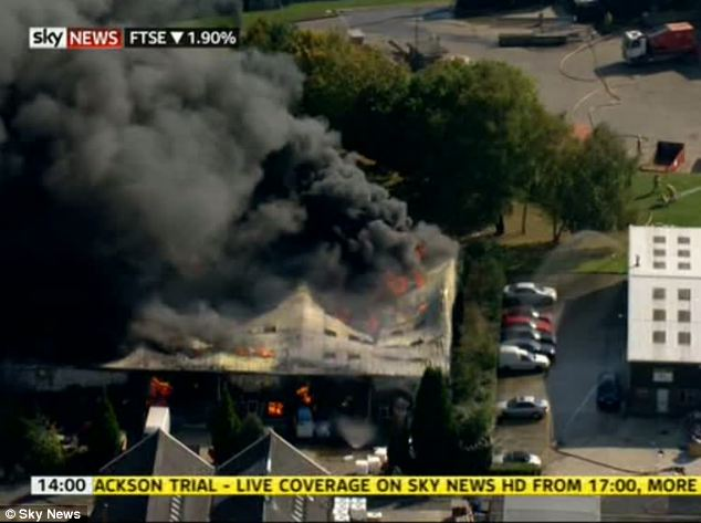 Burning building: At least eight people were injured in the fire which followed a 'massive explosion'