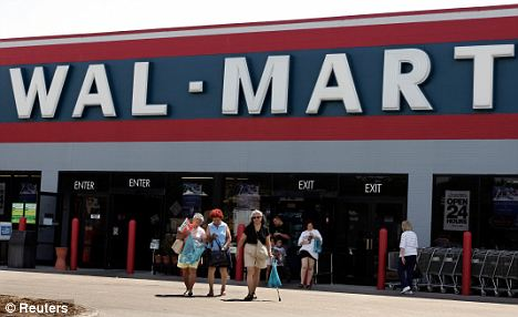 Denial: Wall-Mart says McMillin was verbally abusive and deny she was told to put on a shirt or get out