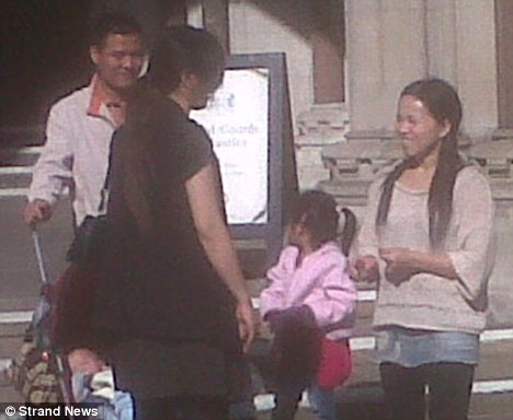 Deportation appeal: Xiu Fang Zhang (right) leaves court with her partner, children and interpreter. She came to Britain in 2003 and was refused asylum shortly after her arrival