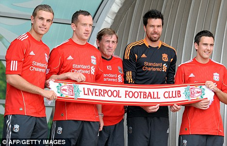 New faces: Kenny Dalglish (centre) unveils Jordan Henderson, Charlie Adam, Alexander Doni and Stewart Downing