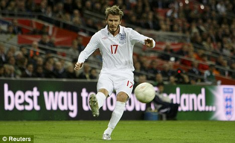 On the ball: Beckham in action for England against Belarus in 2009