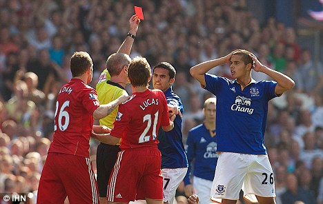 Howler: Jack Rodwell (right) looks stunned as Martin Atkinson sends him off