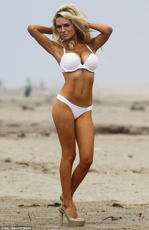All woman: Courtney Stodden poses on the beach for her actor husband Doug Hutchison in a sexy white bikini