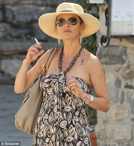 Caught in the act: Catherine this week on holiday in Italy