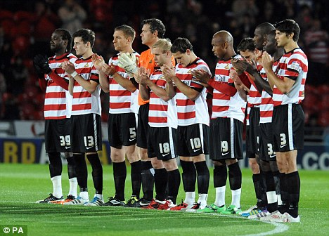 Tribute: Before kick-off there was an emotional minute of applause in honour of Sharp's son
