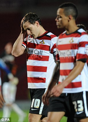Anguish: Sharp (left) shows his conflicting emotions as he leaves the pitch at the final whistle