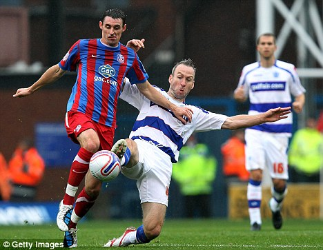 That's how you do it: Shaun Derry (right) battles with Andy Dorman of Crystal Palace