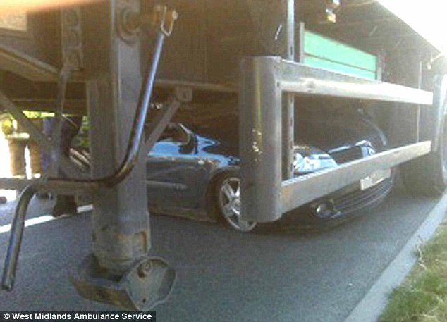 Wedged in: This image shows the extent to which the Renault Clio became pinned under the trailer of the lorry
