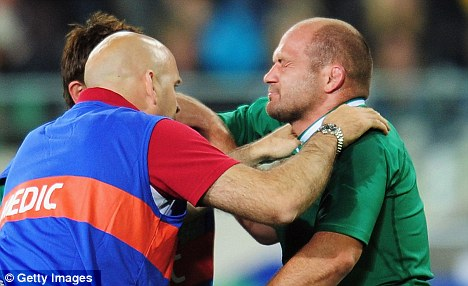 Serious doubt: Rory Best receives treatment on Sunday against Italy