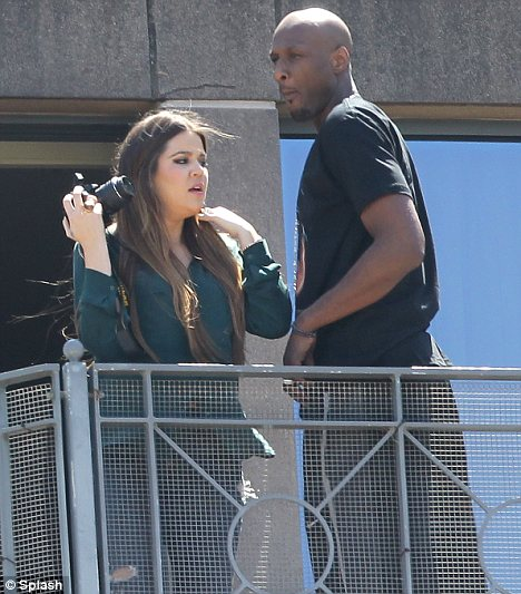 Happy couple: After arriving at their hotel Khloe and Lamar were see taking pictures from their balcony