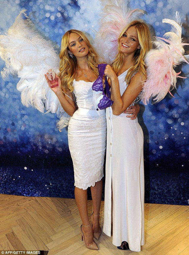 Heavens above! Victoriaís Secret models Candice Swanepoel and Erin Heatherton looked just angelic at a promo photo shoot in New York
