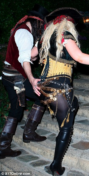 Hello, sexy: Christina Aguilera and her boyfriend Matt Rutler attended a Hallloween party last night in West Hollywood hosted by Maroon 5