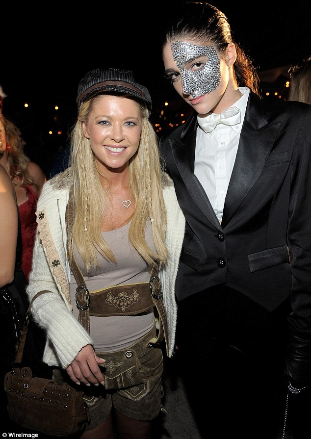 Costume or costume-less? Tara Reid seemed to have gone as...herself