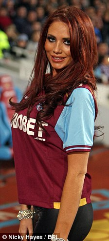 Football fanatic or fanatical freebie lover? Amy donned a West Ham top, but Harry revealed on Twitter they were more interested in the box