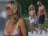 Former British pop star Meg Mathews spends an afternoon at the beach with Damon Williams in Miami Beach, Fl. Meg wore a pink bikini by Kiini swim. The former wife of Oasis guitarist Noel Gallagher in on holiday in Miami with Damon. She was also spotted wearing a gold nose ring at times.  Pictured: Meg Mathews, Damon Williams Ref: SPL1179939  191115   Picture by: Pichichi / Splash News  Splash News and Pictures Los Angeles: 310-821-2666 New York: 212-619-2666 London: 870-934-2666 photodesk@splashnews.com