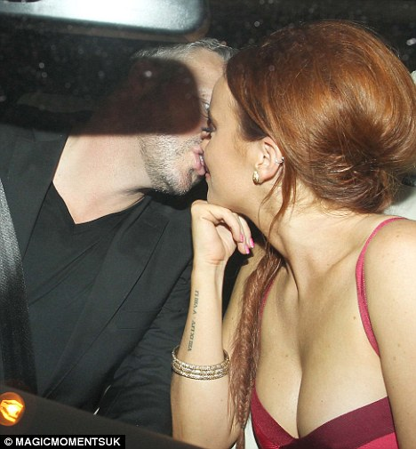 True romance? Mick Norcross and Maria Fowler put on a public display of affection after dinner in Essex and a night at his club Sugar Hut