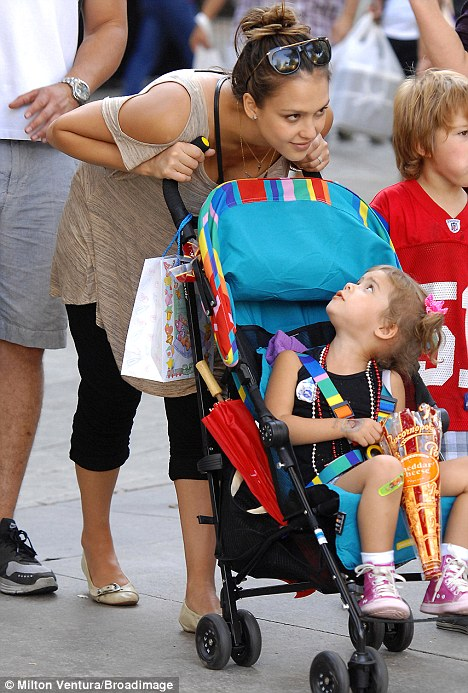 Rest time: The youngster was chauffeured around in her pram throughout their day out the LA County Fair