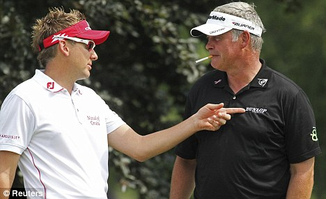 Interested observer: Darren Clarke (right) has a chat with Ian Poulter in Akron