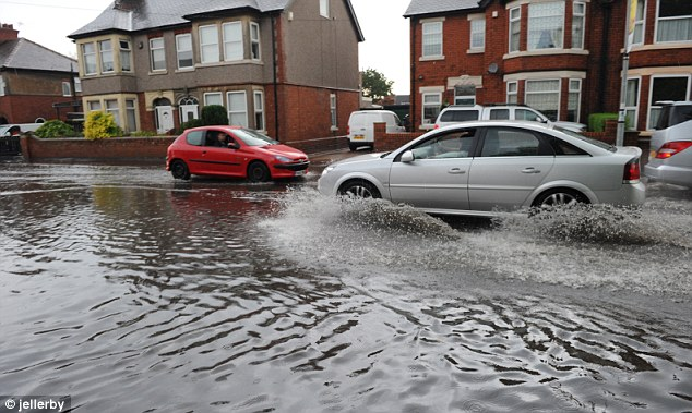 Spray: Traffic eases through the water-logged streets in east Yorkshire after flash flooding yesterday