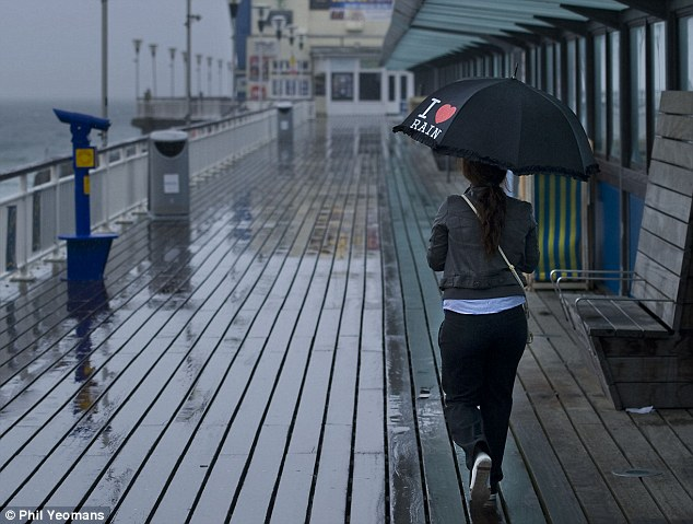 On the boardwalk: Or could they be forced to cover under umbrellas, like this girl on Bournemouth pier in July?