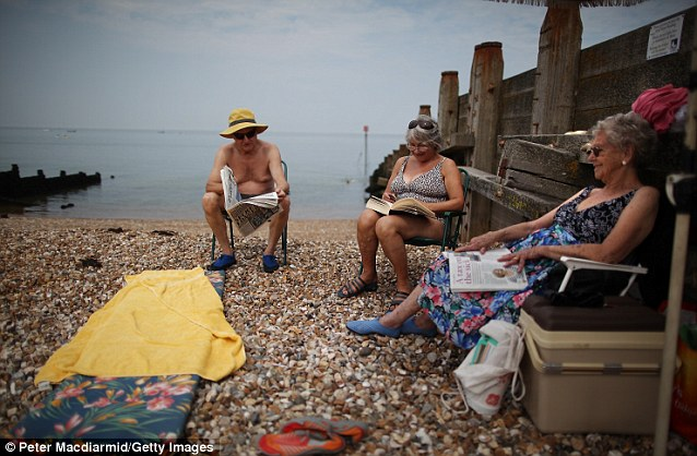 Beach time: Sunseekers lap up the hot weather on a beach in Whitstable yesterday afternoon