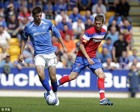 On a knife-edge: Dorin Goian (left) and Rangers trail Malmo 1-0 after the first leg