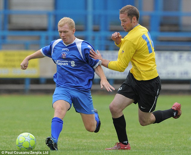 Catch me if you can: Paul Scholes (left) turned out in a charity match at Stalybridge Celtic