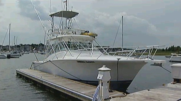 Captured: Karen Ulanowski's boat was too small to fit the shark in it so it had to be hung off the side