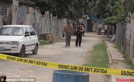 Gruesome: Three men have been arrested after two women were beheaded in their beds in Spanish Town, Jamaica