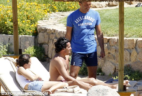 Transfer request: Carlos Tevez (centre) bumped into Inter Milan's head of technical staff Marco Branca (right) while on holiday