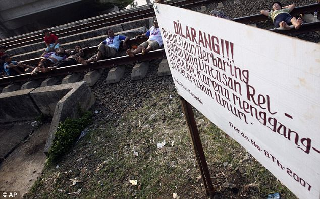 Shutdown: A sign put on by local authority says 'Do not lie/sit on the railway track, it's a violation of public order'