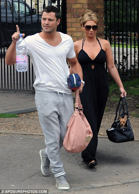 Quitting?: Mark Wright, pictured with his fiancee Lauren Goodger, is said to be considering his future on The Only Way Is Essex in a dispute over pay