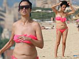 EXCLUSIVE: Chantelle Houghton seen on a beach in Majorca wearing an ill fitting bikini. It looks like yoyo dieter Chantelle has piled on the pounds again after earlier in the year losing 3 stone  Photos taken on October 6th 2015  Ref: SPL1134067  201115   EXCLUSIVE Picture by: Splash News  Splash News and Pictures Los Angeles: 310-821-2666 New York: 212-619-2666 London: 870-934-2666 photodesk@splashnews.com