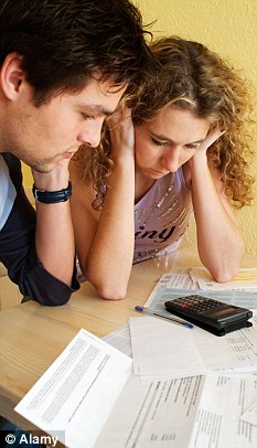Teetering: Economists say a 0.5 per cent increase in interest rates could mean families need to find an extra £516 a year to pay their mortgage