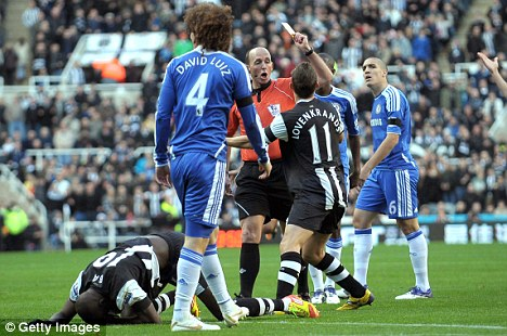 Yellow escape: Mike Dean cautions David Luiz when the defender should have seen red