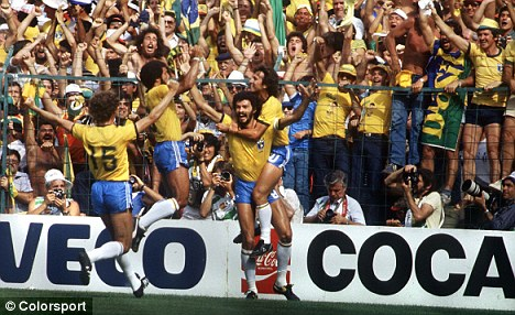 Success: Socrates is mobbed after scoring for Brazil