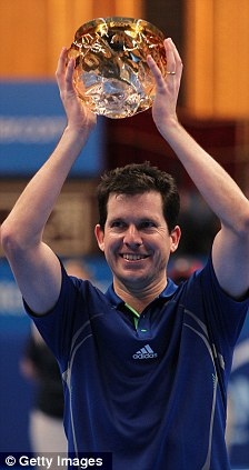 Henmania: Former British No 1 Tim Henman lifts the trophy after defeating Thomas Enqvist in the AEGON Masters final at the Royal Albert Hall