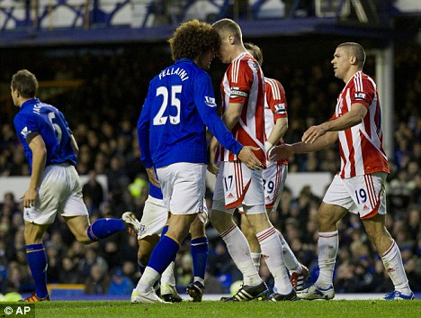 Clash: Fellaini confronts Shawcross in the first half at Goodison Park