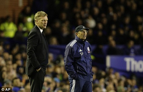 Bad day at the office: Everton manager David Moyes (left)