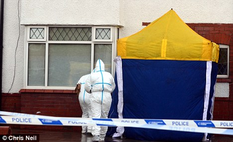 Probe: Forensic officers investigate the house where the bodies of two women were found in Southport late on Saturday afternoon
