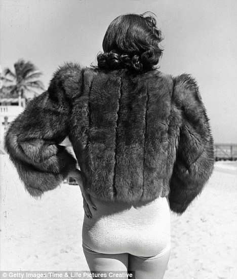 Out of sync: Who plans to hit the beach this summer in a winter coat?