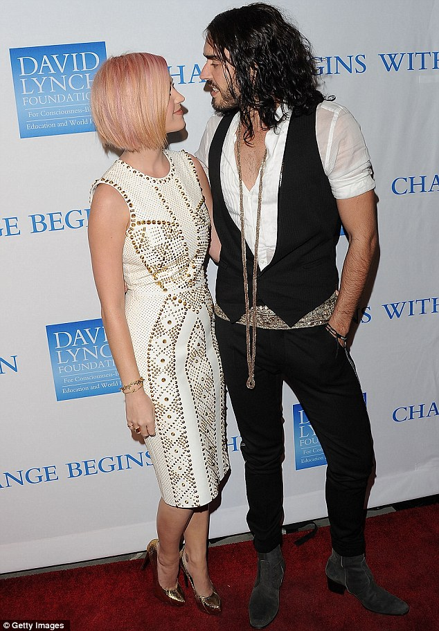 The look of love: Russell Brand and Katy Perry couldn't keep their eyes off each other as they stepped out on the red-carpet for a charity event at the  LACMA in Los Angeles this evening