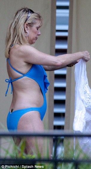 Revealing: With her swimsuit's low-cut at the back and cut-outs to the sides, Ramona put plenty of flesh on display